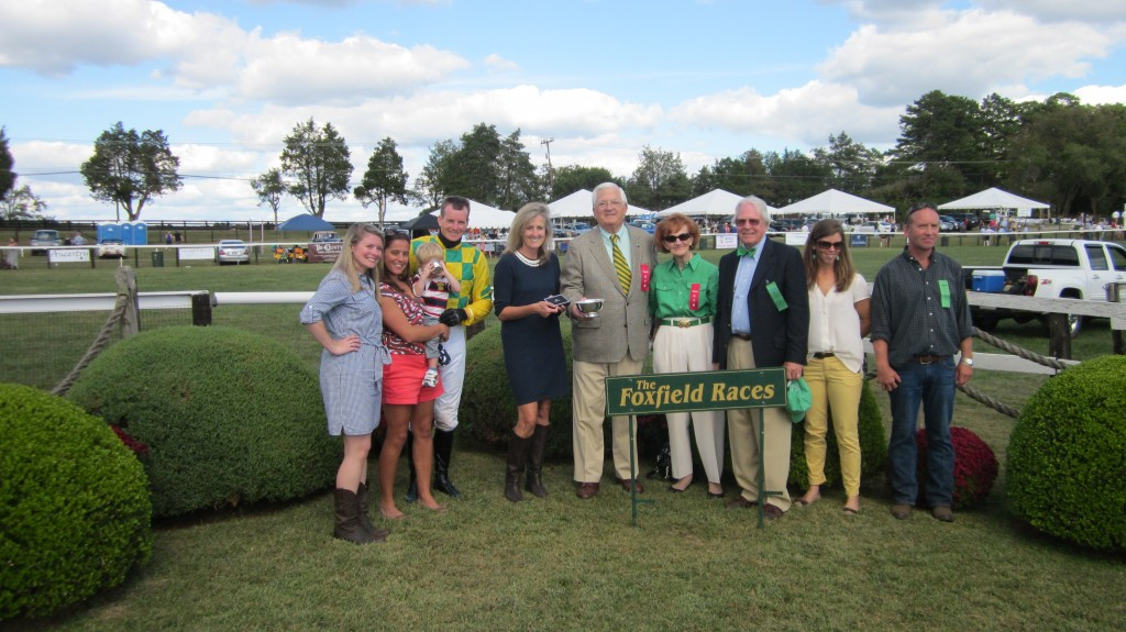 W. Patrick Butterfield and vineyard vine staff present trophies and The 2013 vineyard vines Official Foxfield Bow Tie to the winner of the Virginia-bred-or-sired race.