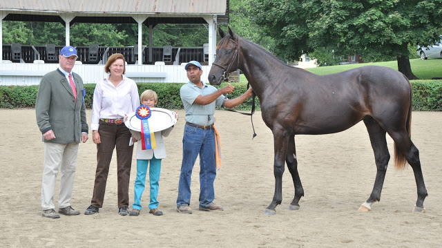 Virginia-bred Just Call Kenny, 2012 Yearling Futurity Grand Champion, with breeder Robin Richards.