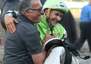 Trainer Marcus Vitali (L) and Jockey Nik Juarez celebrate in the Winners Circle at Monmouth Park in Oceanport, New Jersey on Sunday August 30, 2015, after Juarez guided the Vitali trained Valid to victory in the $150,000 Philip H. Iselin Stakes.  Photo By Bill Denver/EQUI-PHOTO