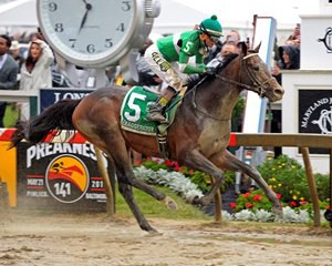 Exaggerator's win in the Preakness (shown here from Anne Eberhardt) and Nyquists's Derby win helped boost interest and betting handle in the month of May