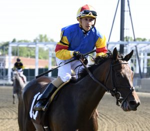 Jockey Alex Cintron was atop Queen Caroline in Saturday's Nellie Mae Cox Stakes.